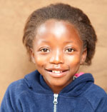 portrait photo of Tikho, a young Zambian girl