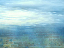 underwater angle on a brick wall, above is brightly lit surface